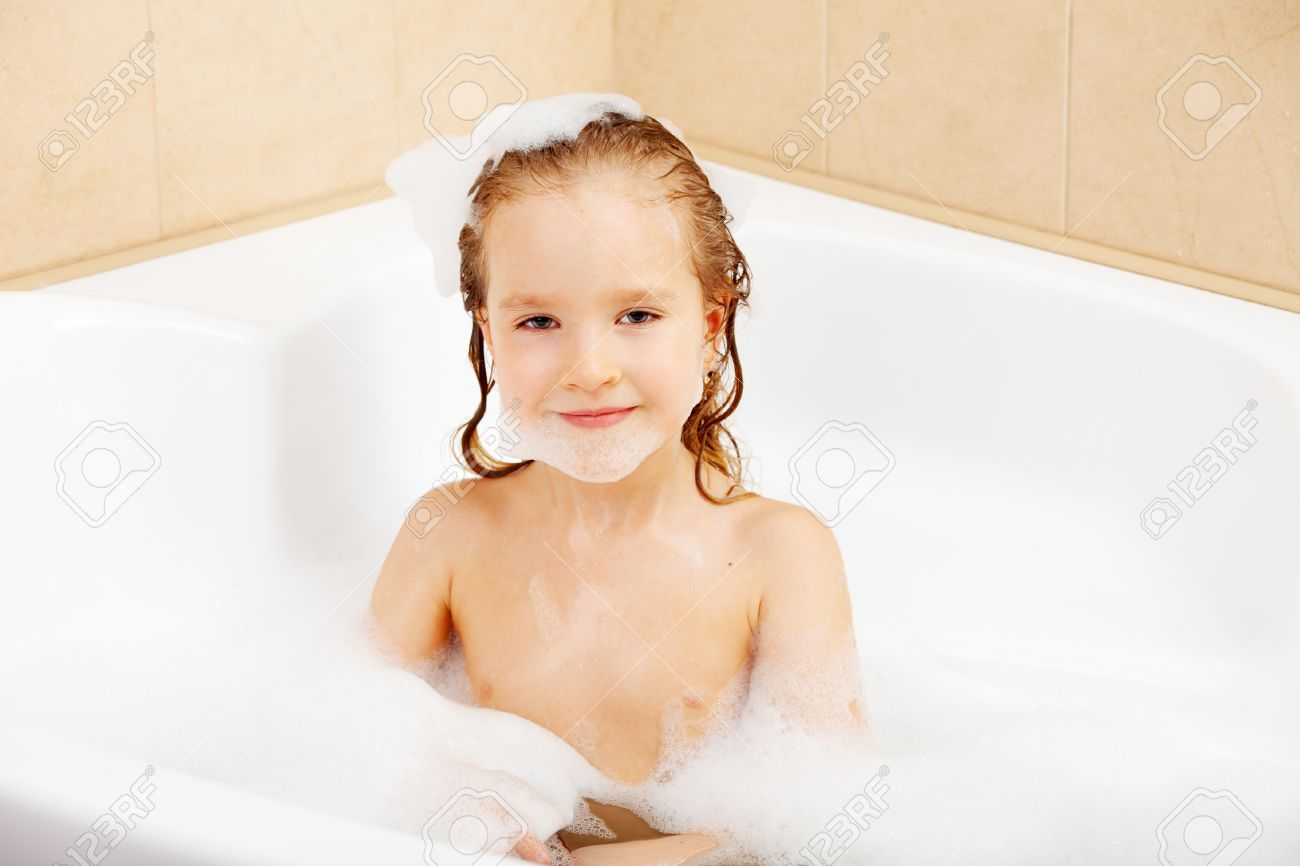 Amazing Child In The Bathtub. Girl Washes In The Bathroom Stock Photo   16165637