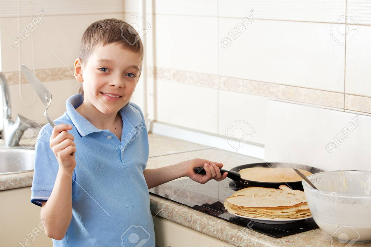 Child Bakes Pancakes In The Kitchen Boy Cooking Breakfast Stock Photo Picture And Royalty Free Image Image 20606600