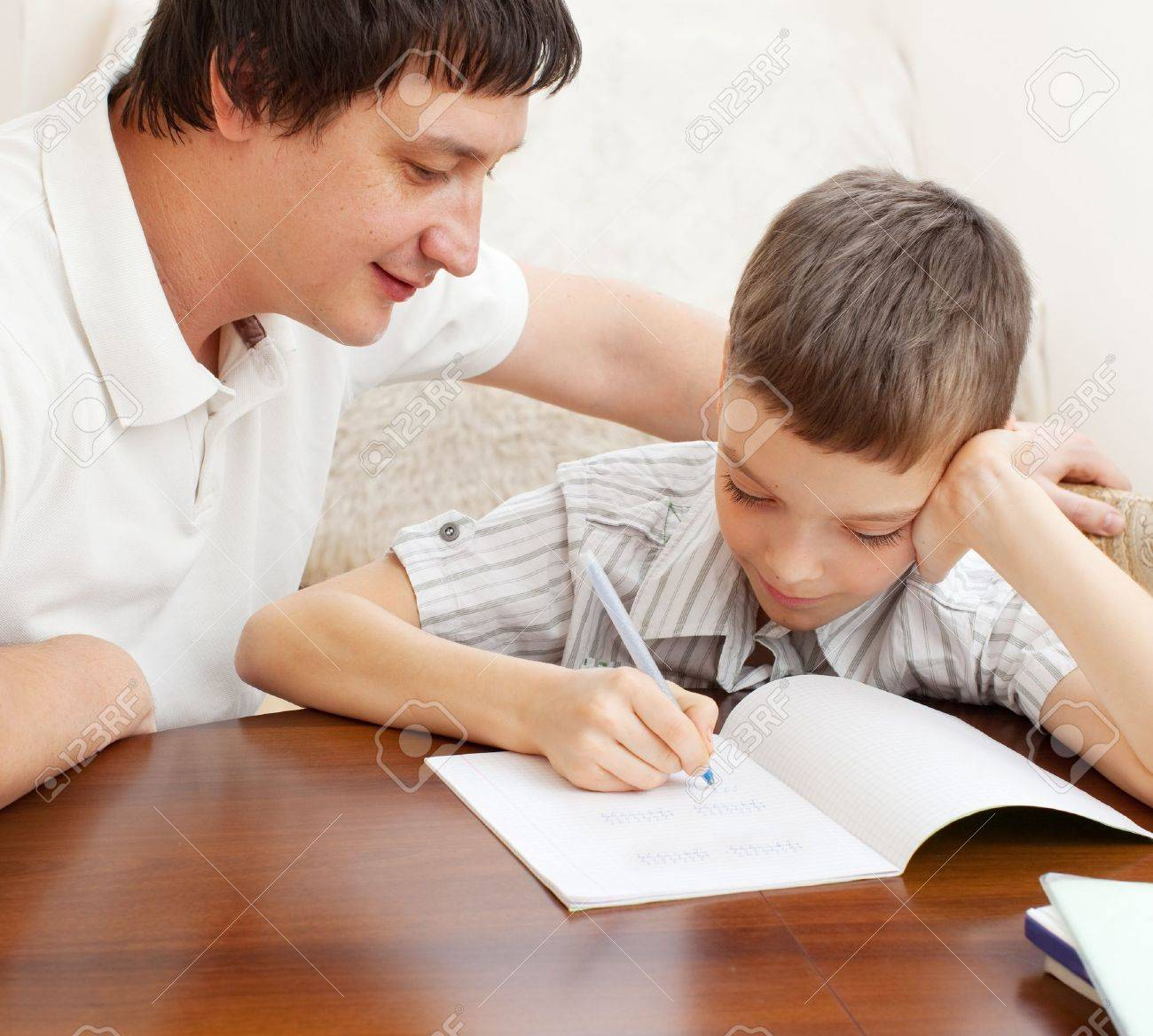 Father Helping Son Do Homework. Parent Helps His Child Stock Photo ...