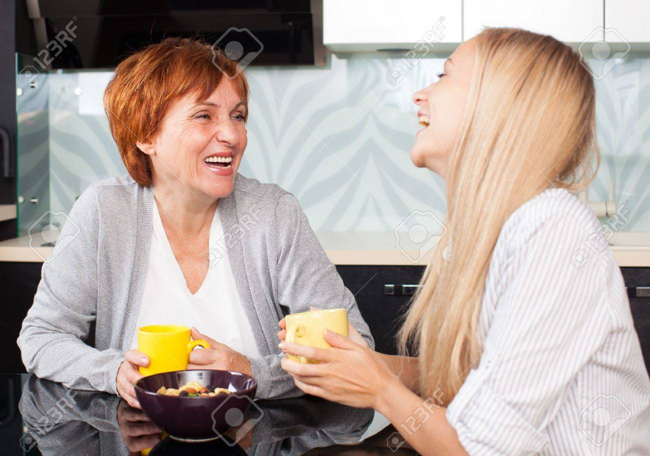Mother and daudhter talking on the kitchen. Women at home Stock Photo - 19203945
