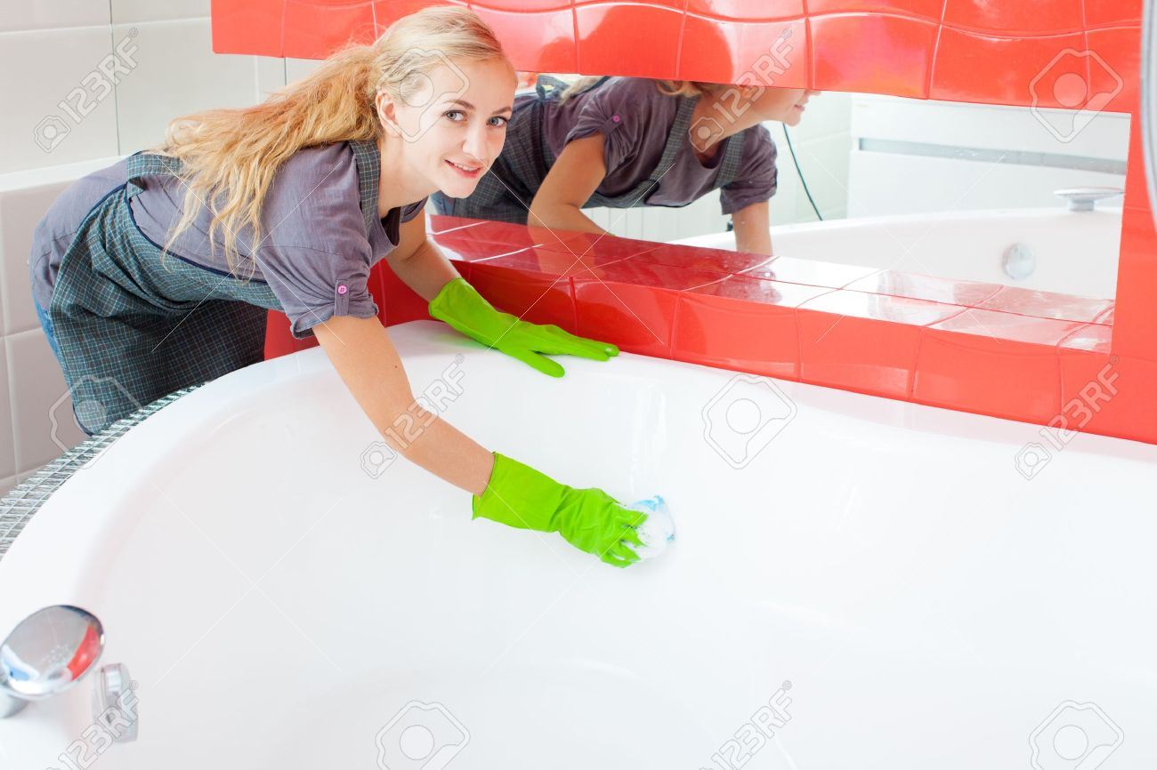 Woman Cleaning Bath At Home Female Washing Bathtub Tub Stock Photo - Best thing to clean bathtub