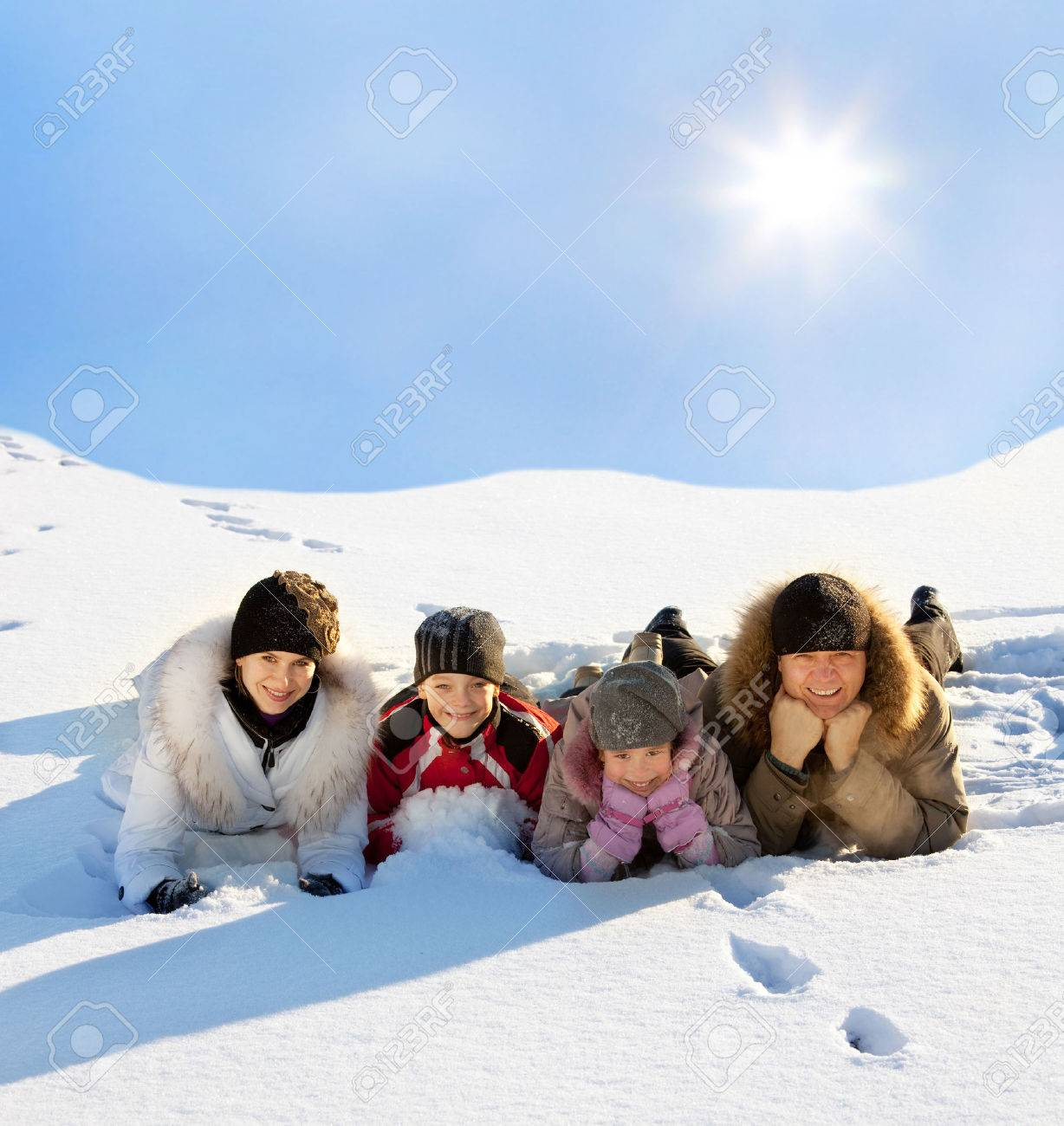 Family with children in the snow in winter. Stock Photo - 23559598