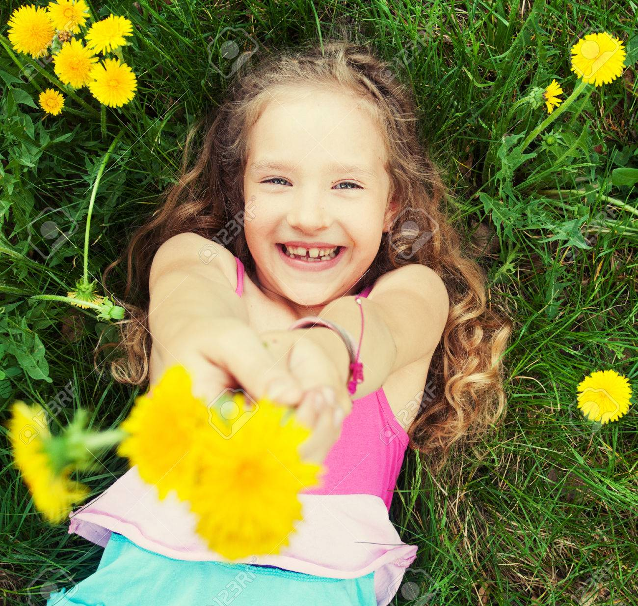 Child at summer. Happy girl outdoors on green grass - 28387861