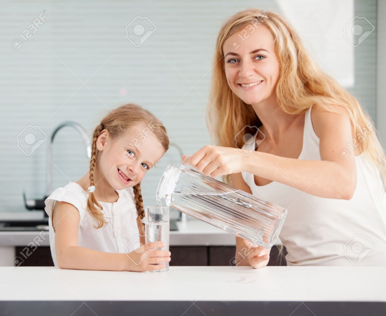 Home Drinking Water Child With Mother Drinking Water From Glass Happy Family At