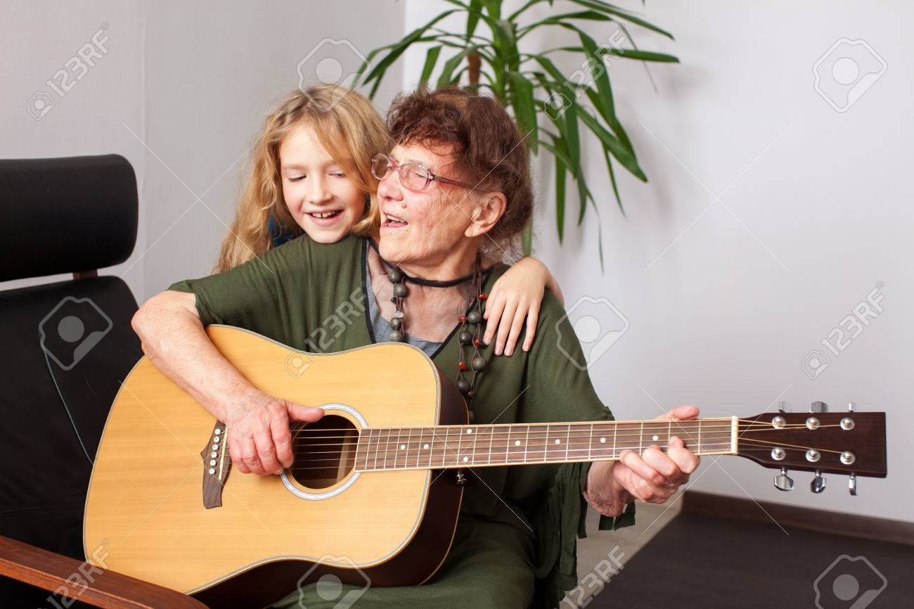 90 year old grandmother to play the guitar. elderly woman with