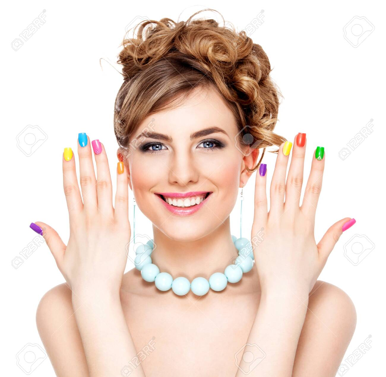 Young woman portrait with colorful makeup and nail polish, manicure, studio shot - 141605570
