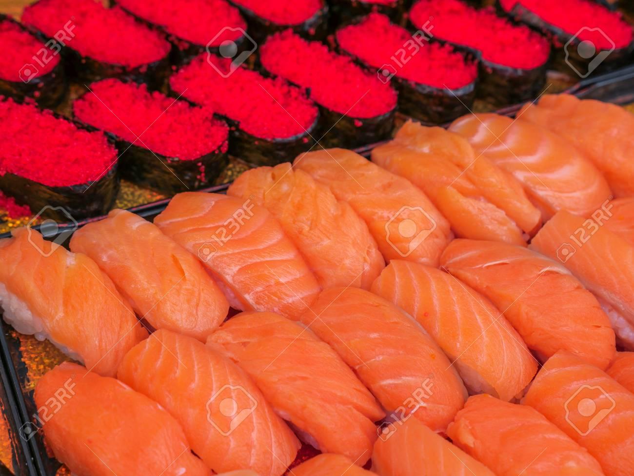 salmon nigiri, salmon sushi with tobiko (flying fish egg) sushi