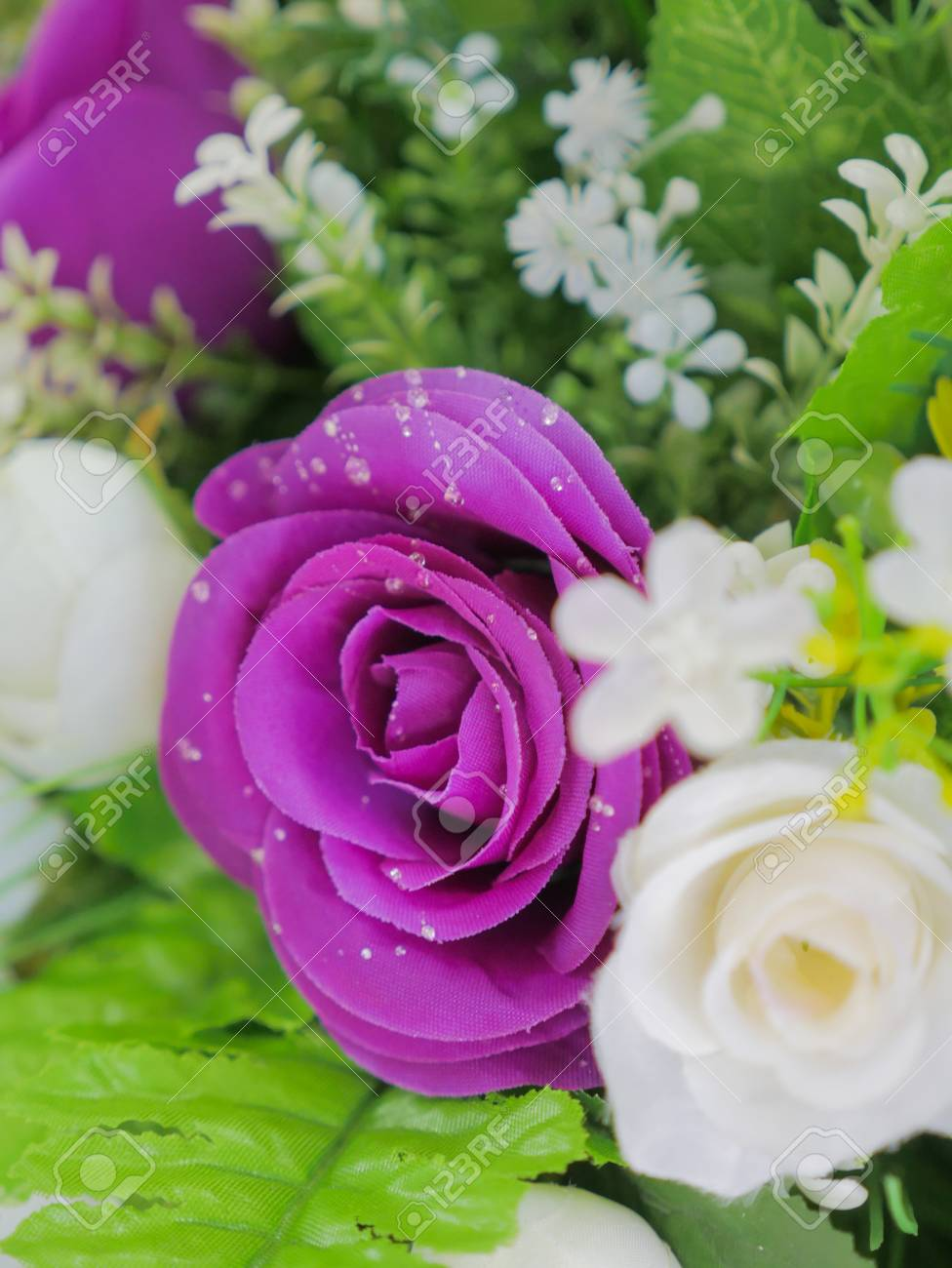 Elegant and beautiful fake purple rose flowers with artificial elegant and beautiful fake purple rose flowers with artificial water drop stock photo 83079502 mightylinksfo