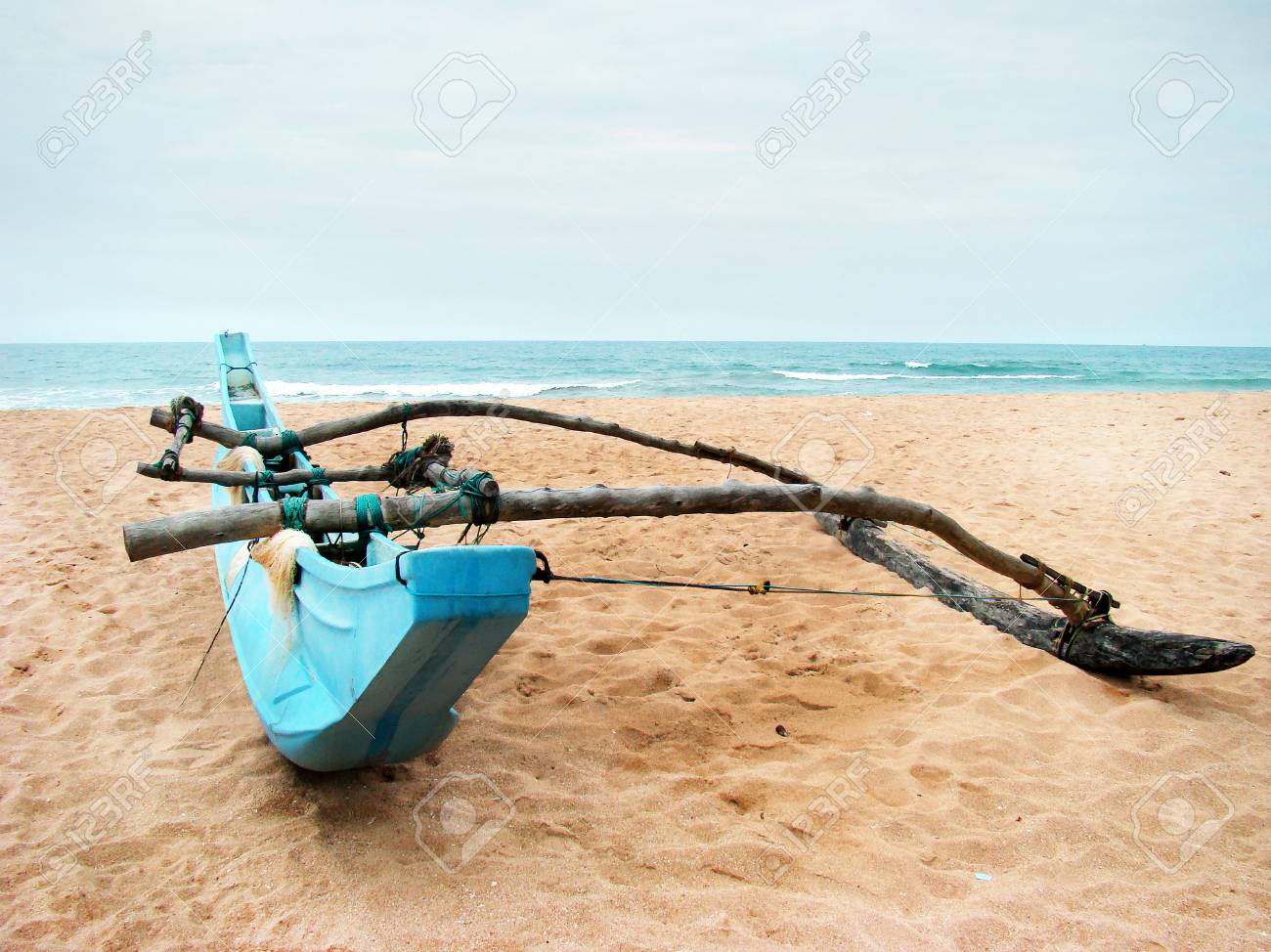 Homemade Single Outrigger Kit for Swagman Canoe on Sandy Beach Overlooking Ocean and Horizon - Summer active sports and recreation. - 101922429