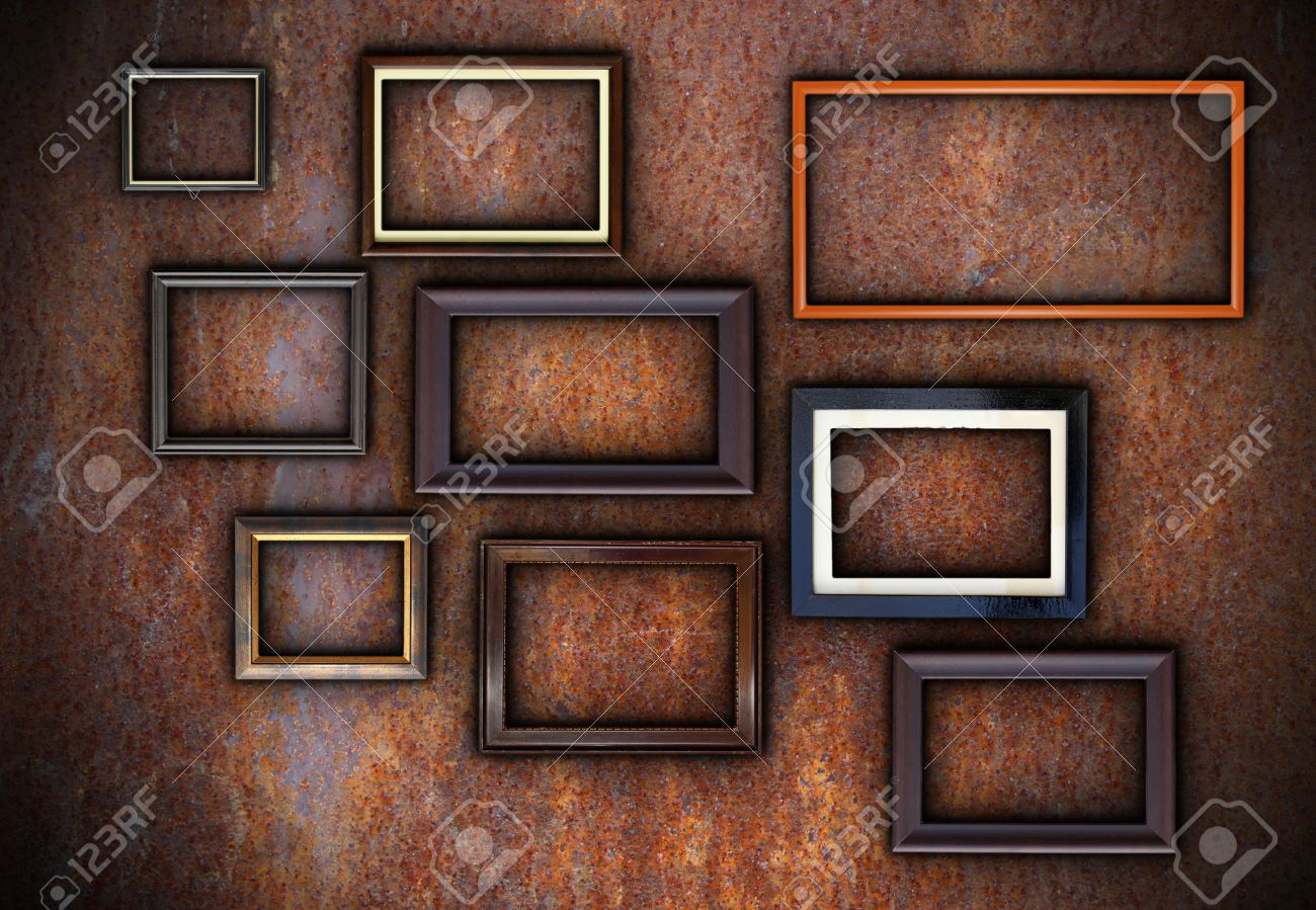 rusty wall full of empty frames ready for your design or message stock photo 26138326 - Empty Frames On Wall
