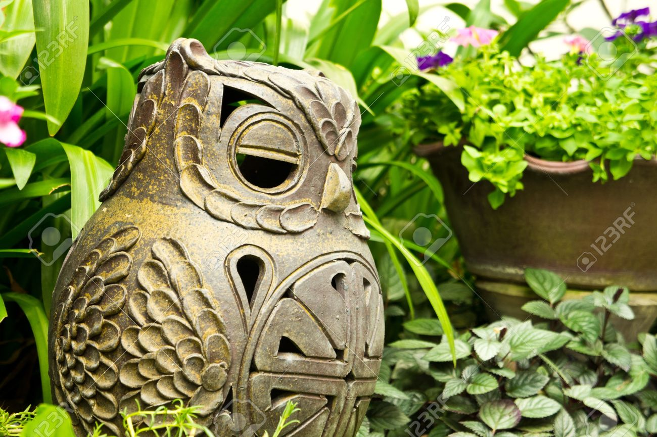 Clay Owl In The Garden Stock Photo Picture And Royalty Free Image