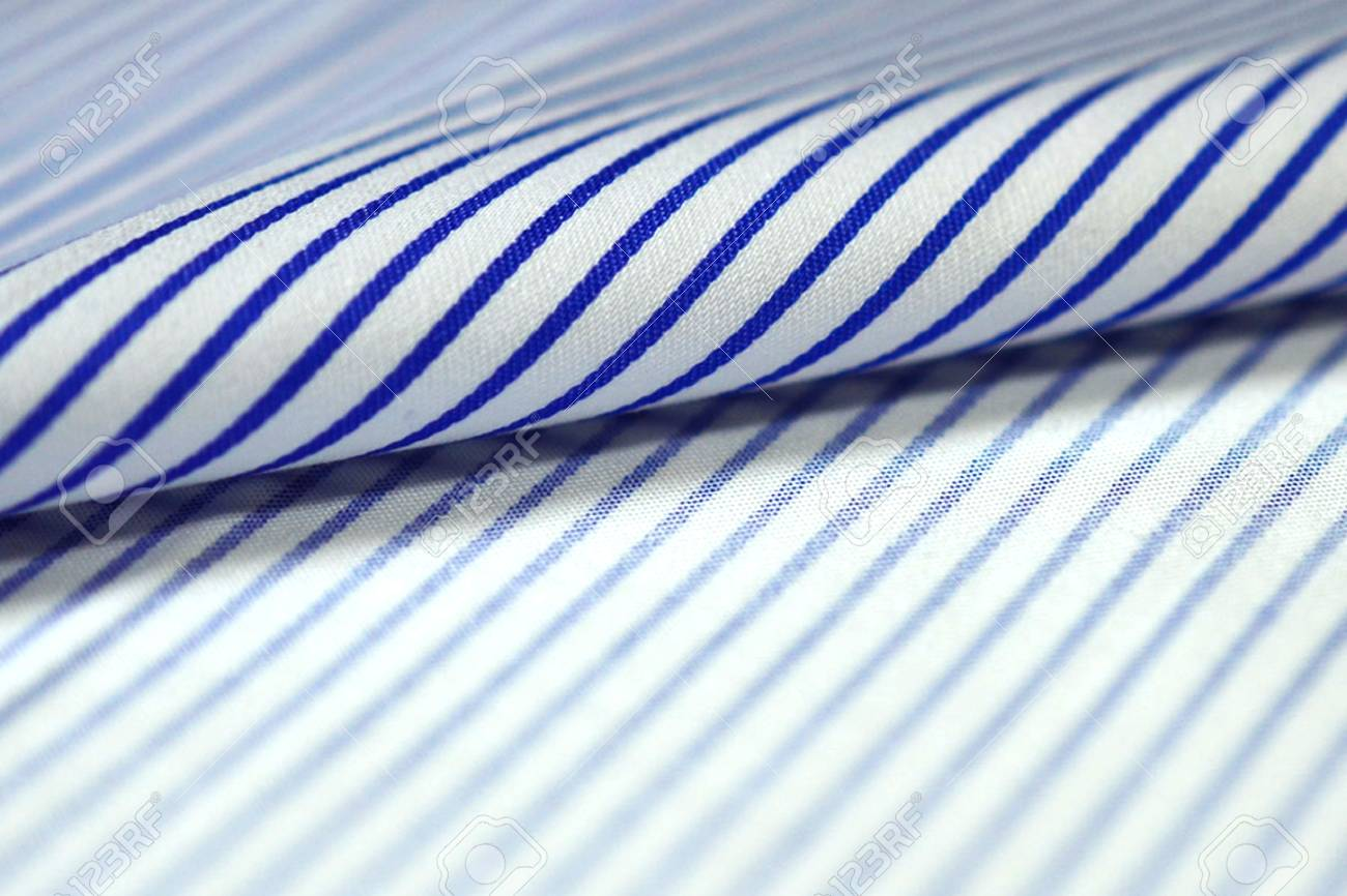 8d47995c65 close up roll thin blue line and white fabric of shirt, photo shoot by depth