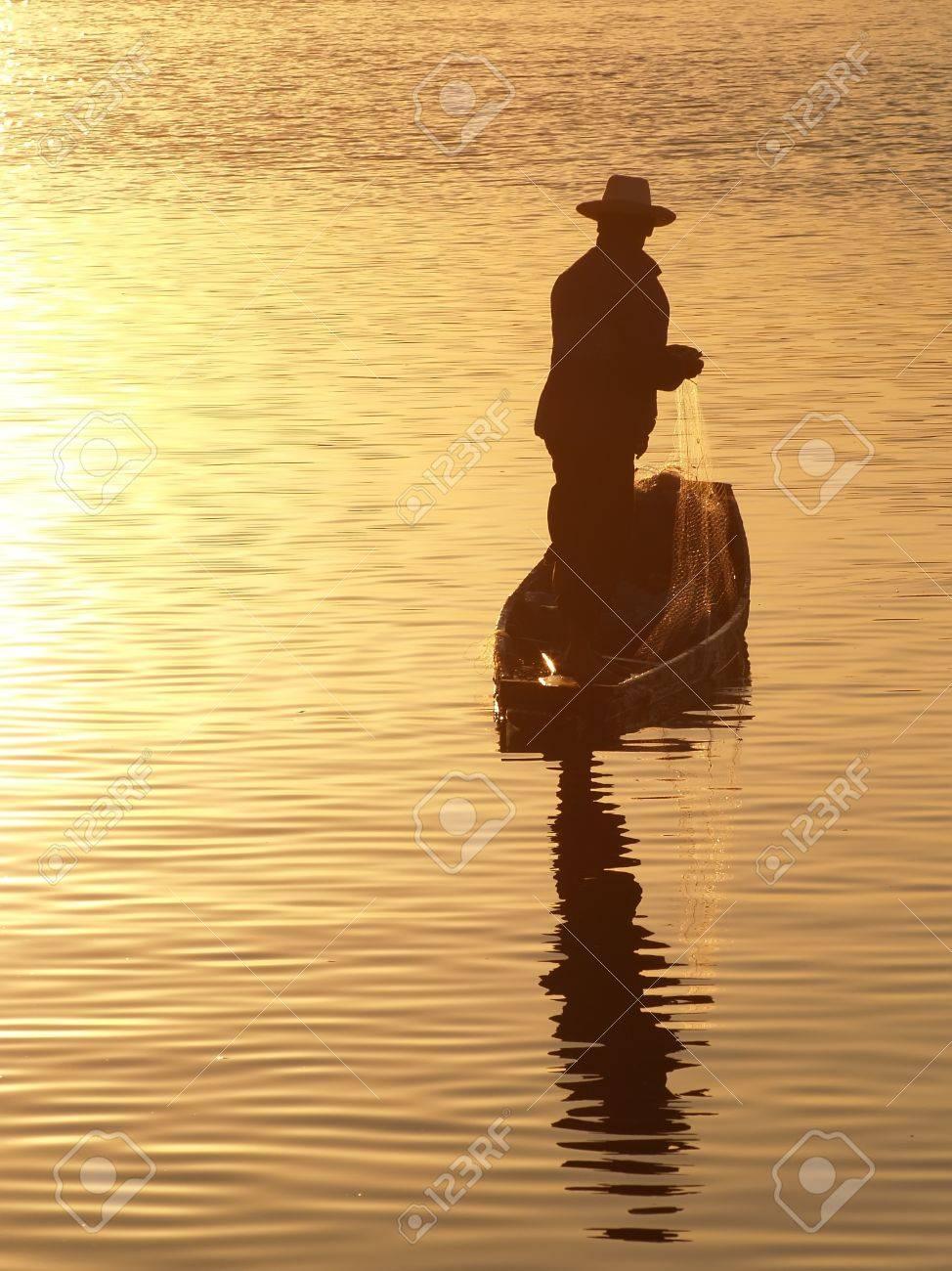 Fisherman in sunlight Stock Photo - 16776396