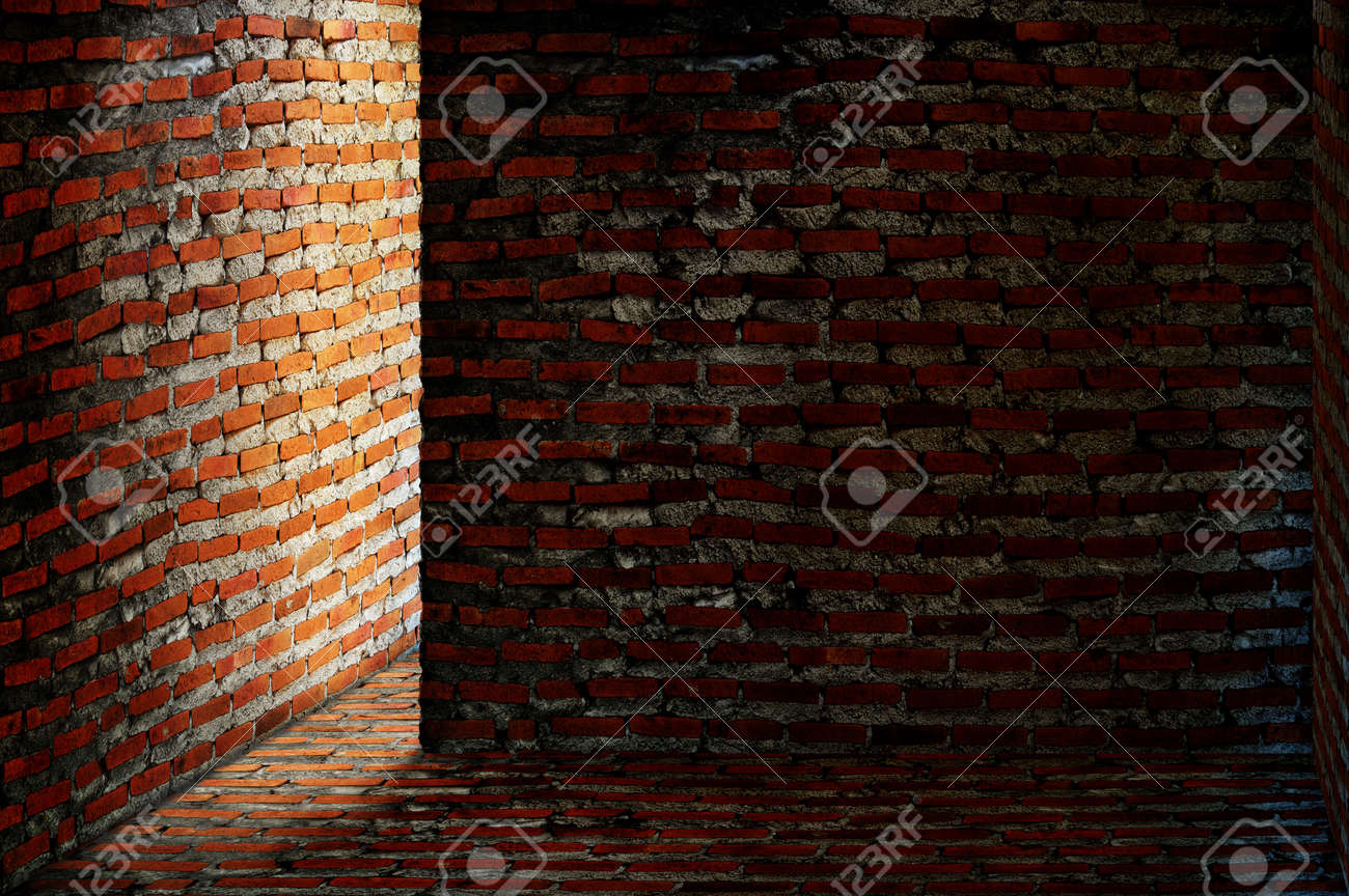 Dark brick room with light shining around a corner Stock Photo - 8912178