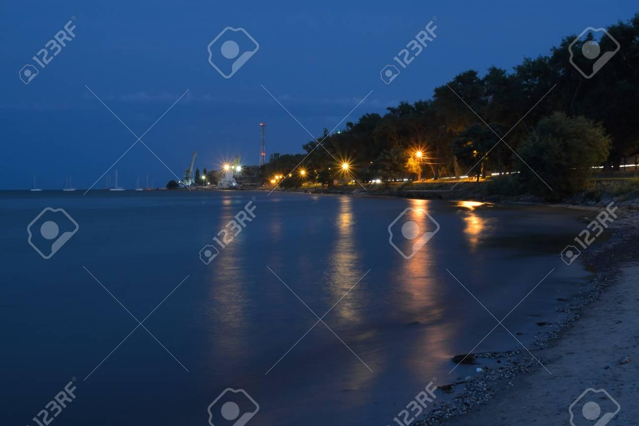 Coastal City Esplanade At Night Lights Flashing Along Sea Front In Summer.  Stock Photo