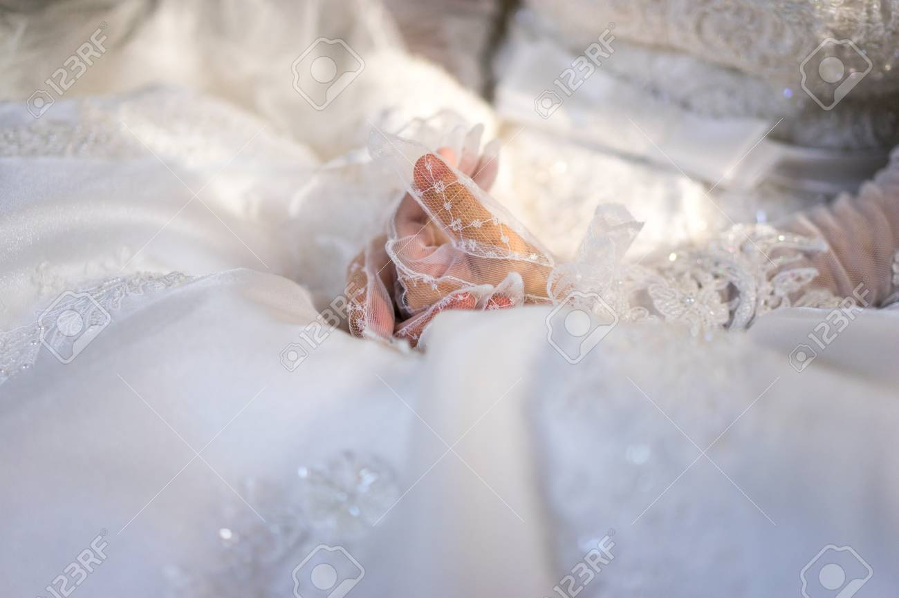 Woman In White Wedding Dress Bride Hands In White Bride Gloves Stock Photo Picture And Royalty Free Image Image 107498526