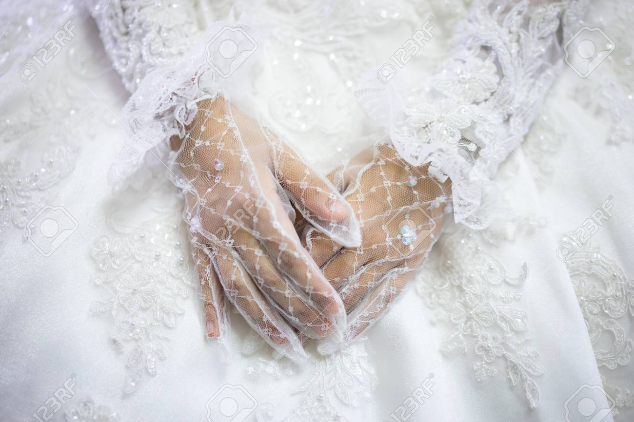 Woman In White Wedding Dress Bride Hands In White Bride Gloves
