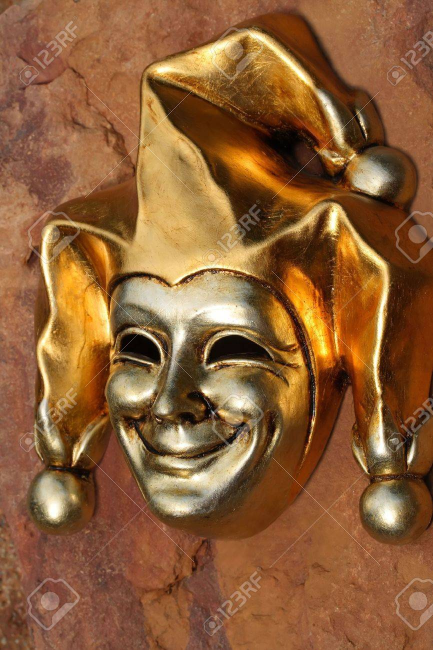Golden Venetian mask of smiling joker Stock Photo - 957178