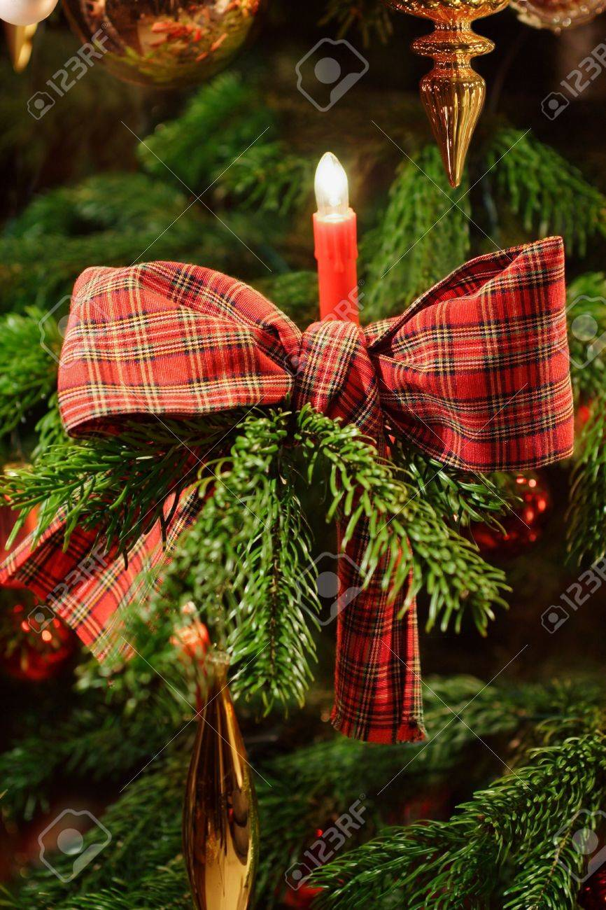 Candle on christmas tree with checkered ribbon Stock Photo - 4098223