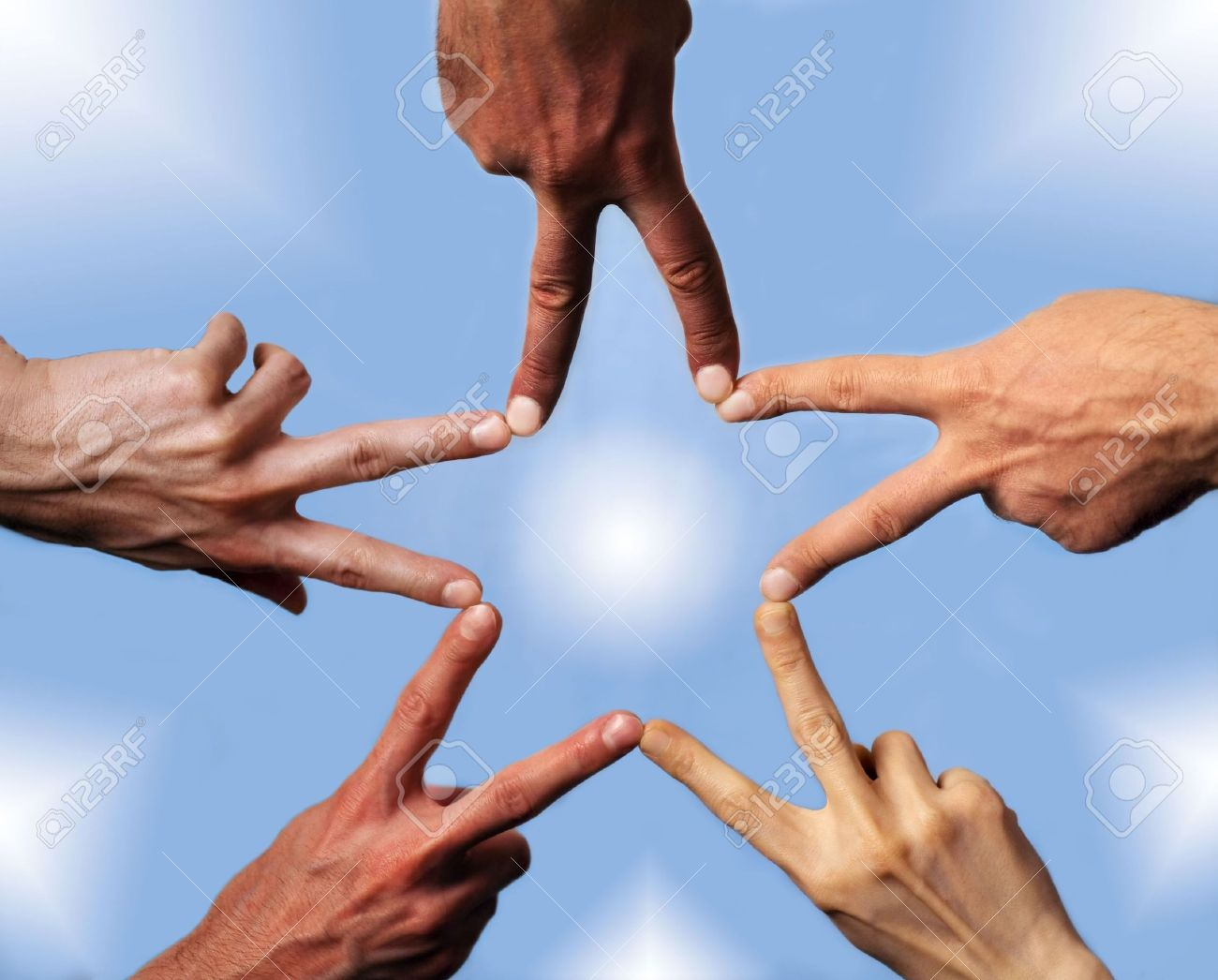 Five hands with different skin-color, their fingers building a star Stock Photo - 5913945