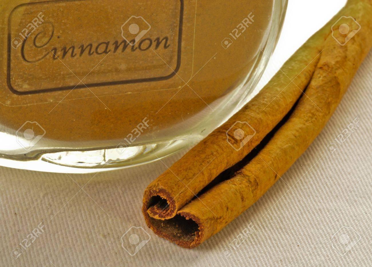 cinamon ground in jar with cinamon sick Stock Photo - 8278863