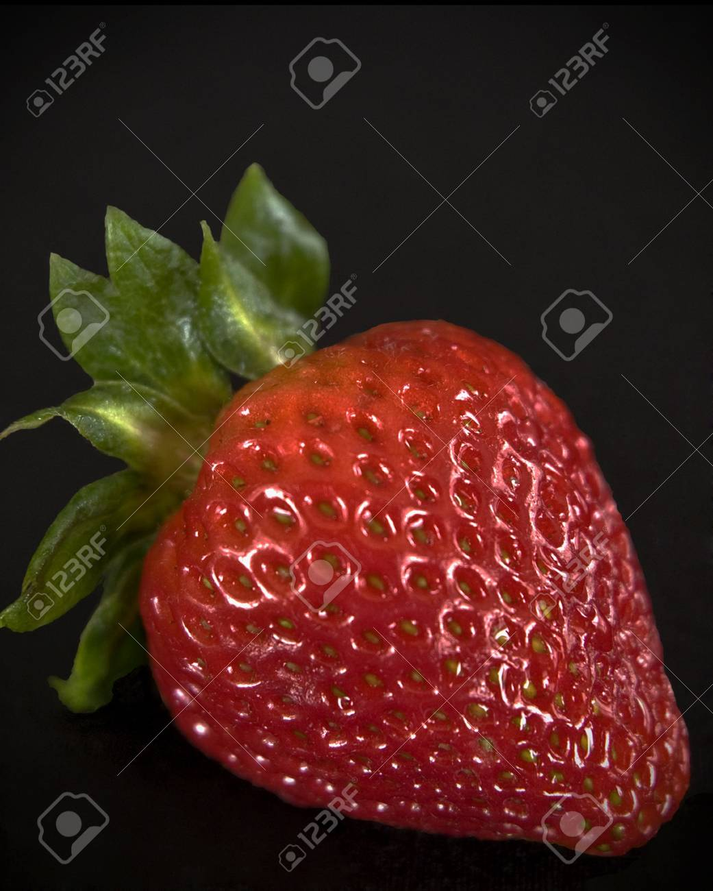Starwberry close up on black background Stock Photo - 8287660