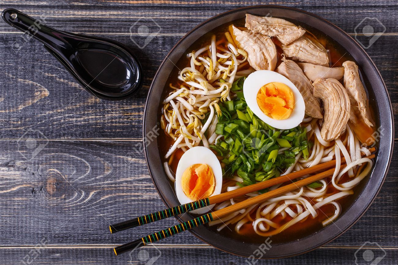 Japanese ramen soup with chicken, egg, chives and sprout on dark wooden background. - 53701408