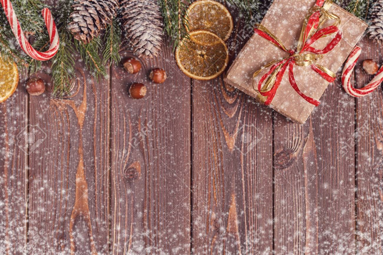Christmas gift boxes and fir tree on wooden background  Top