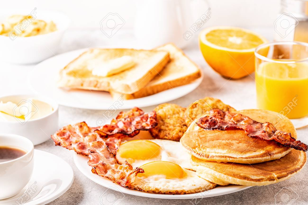 Healthy Full American Breakfast with Eggs Bacon Pancakes and Latkes, selective focus. - 114331707