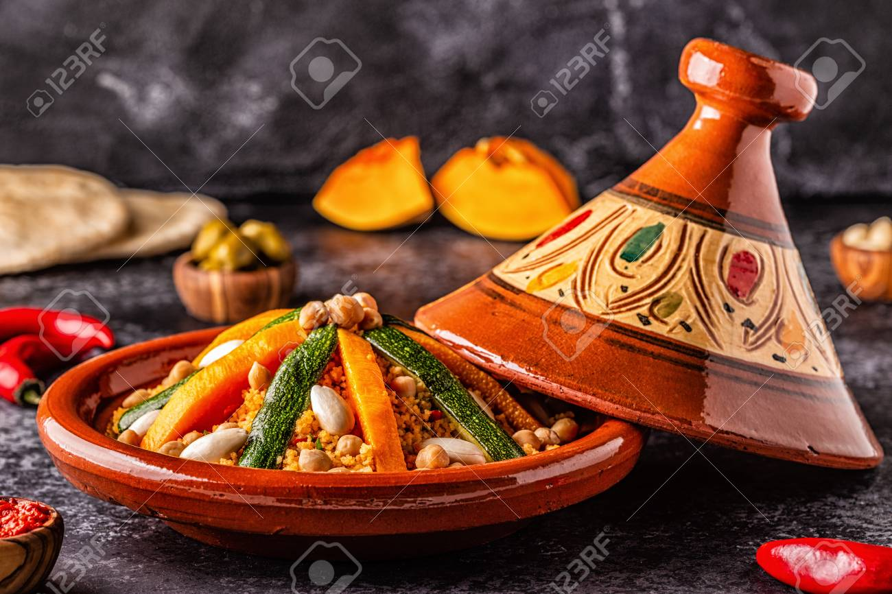 Vegetable tagine with almond and chickpea couscous, selective focus. - 120959661