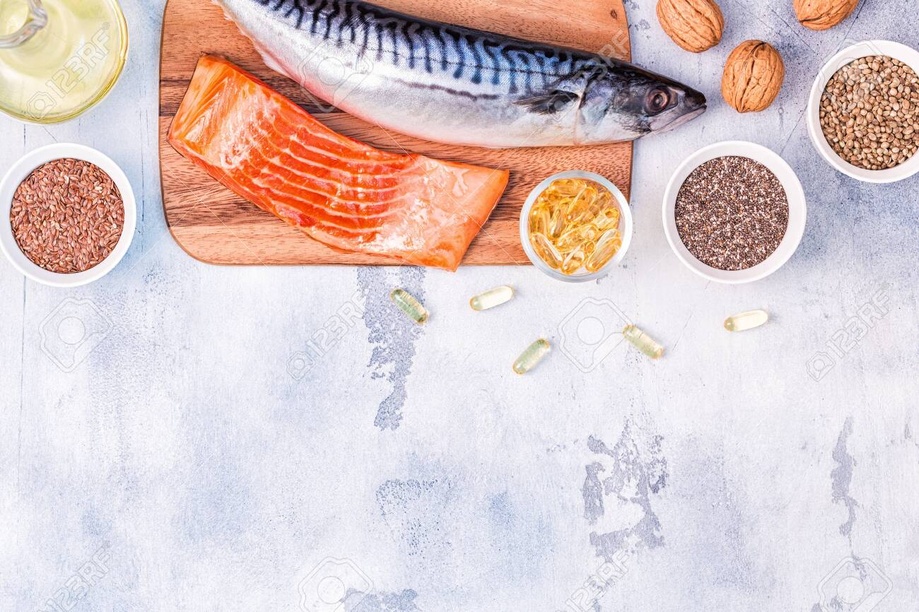 Sources of omega 3 - mackerel, salmon, flax seeds, hemp seeds, chia, walnuts, flaxseed oil. Healthy eating concept. Top view with copy space. - 121667826