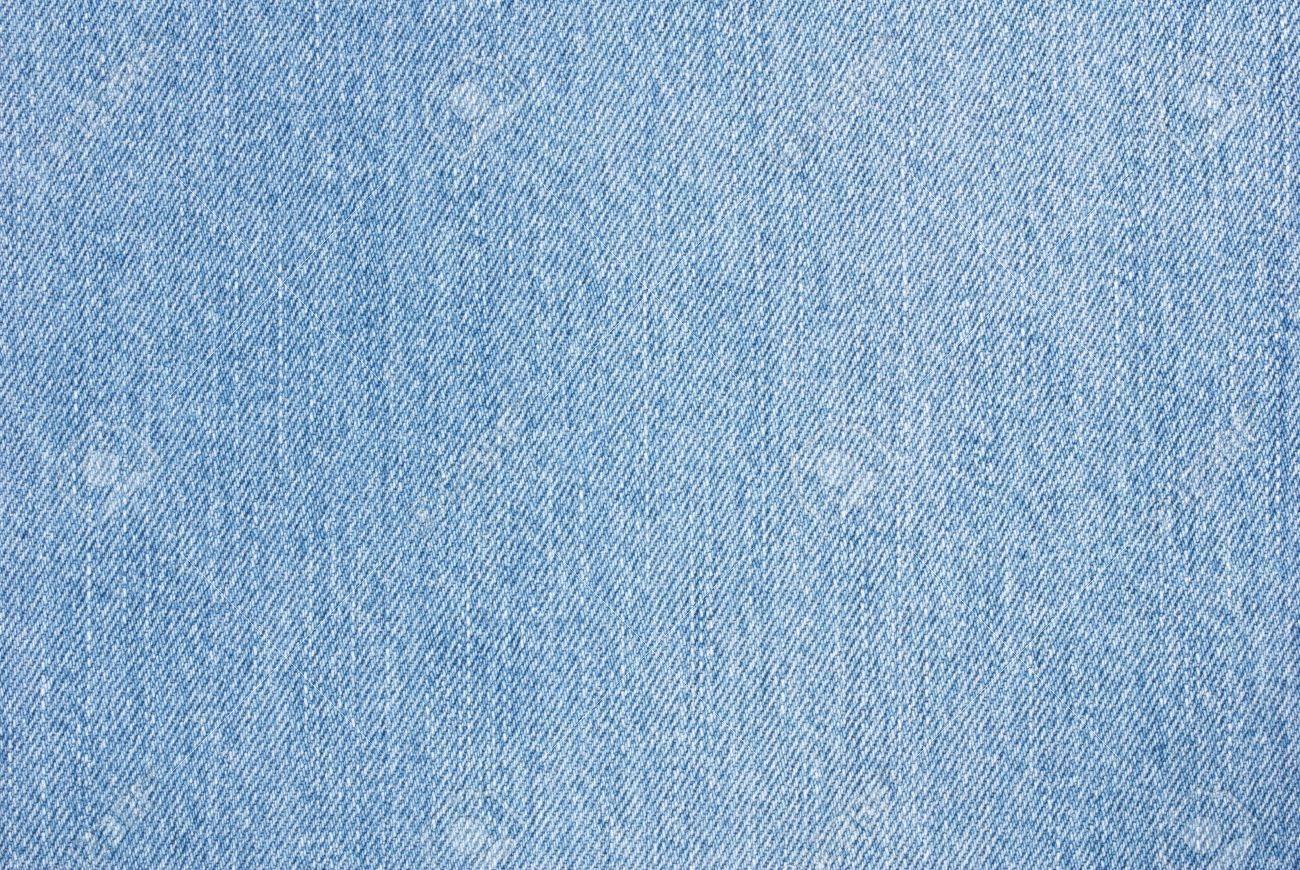 クローズ アップの青デニム生地の背景や壁紙として使用するため の写真