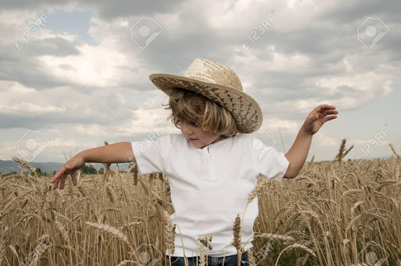 Boy in a wheat field Stock Photo - 10718780