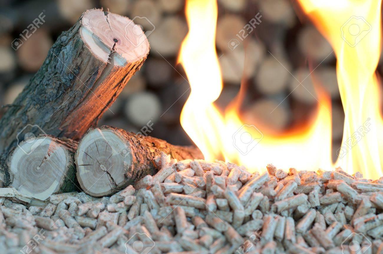 Oak Pellets in  flames- chopped firewood background Stock Photo - 15657435