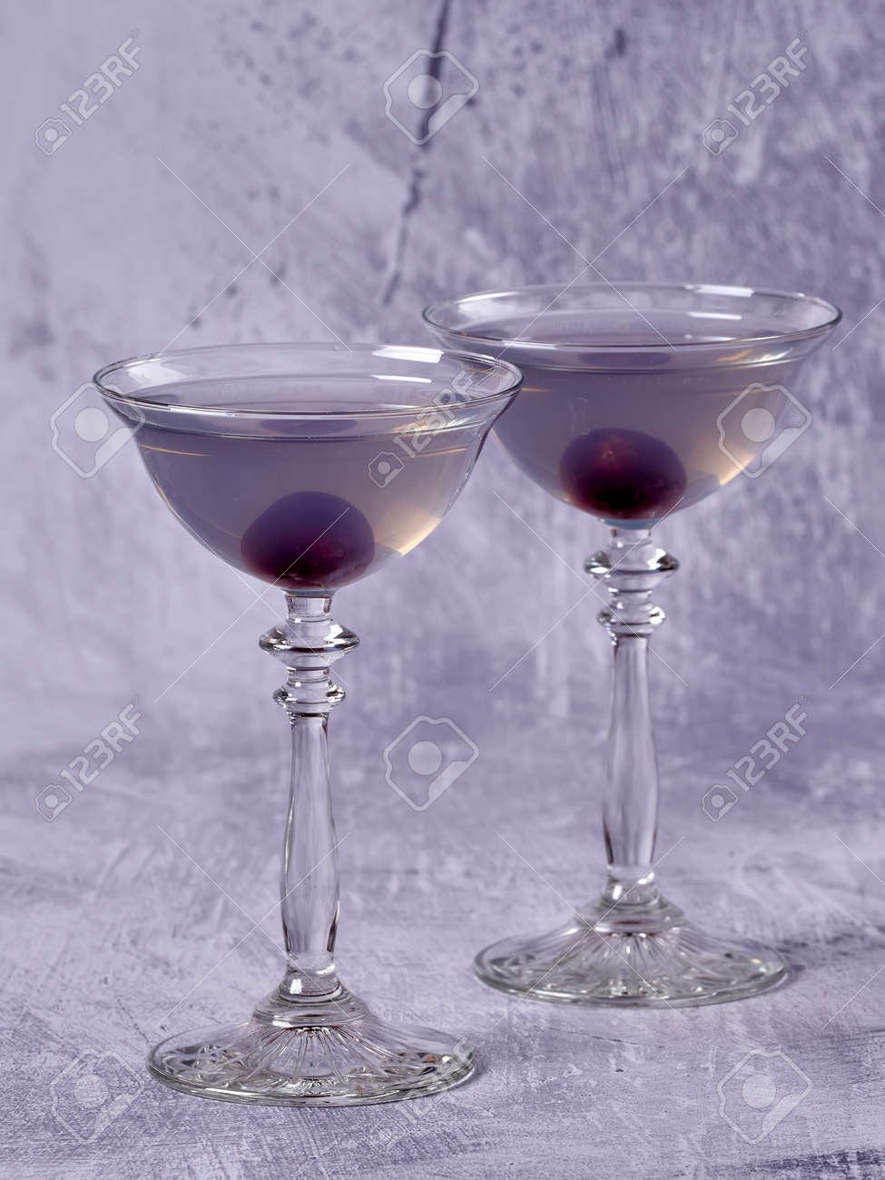 Aviation: a purple-bluish cocktail made with gin, maraschino, creme de violette and a dash of lemon juice, served with a maraschino cherry - 157025467