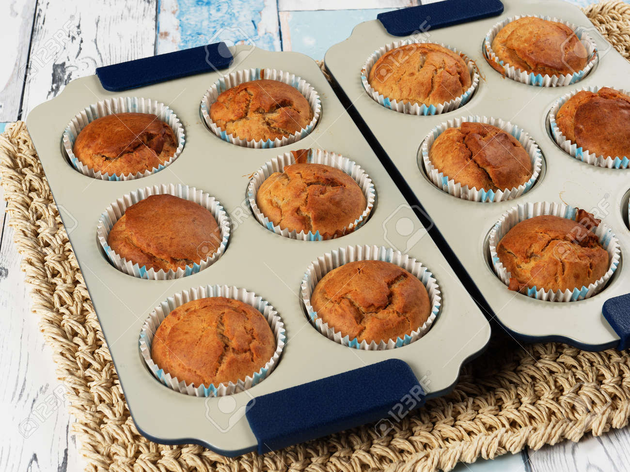 Homemade banana muffins in trays. No sugar added. Toddler food. - 169668303