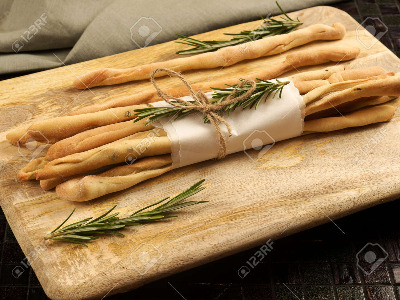 Homemade grissini with rosemary - 169668313