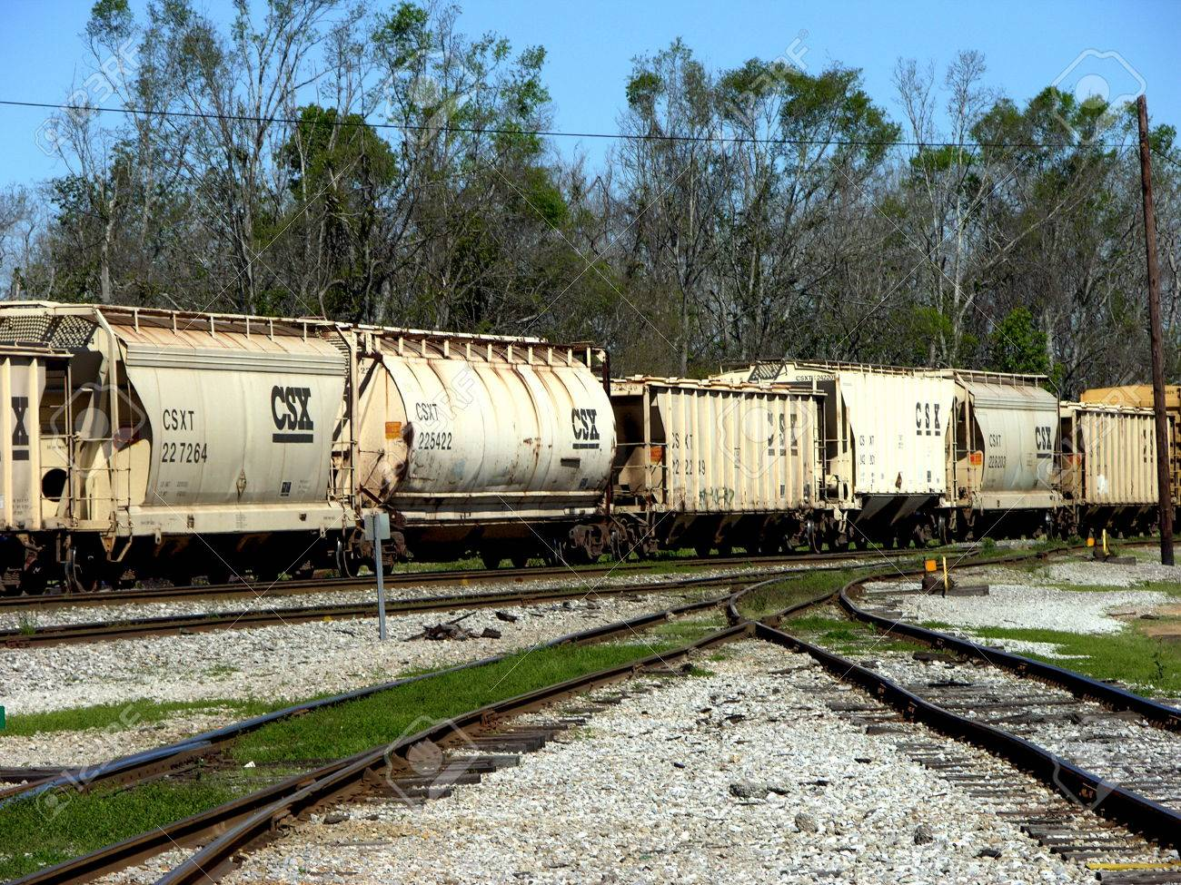 A Row Of Freight Train Cars Sitting At A Train Yard In Pensacola
