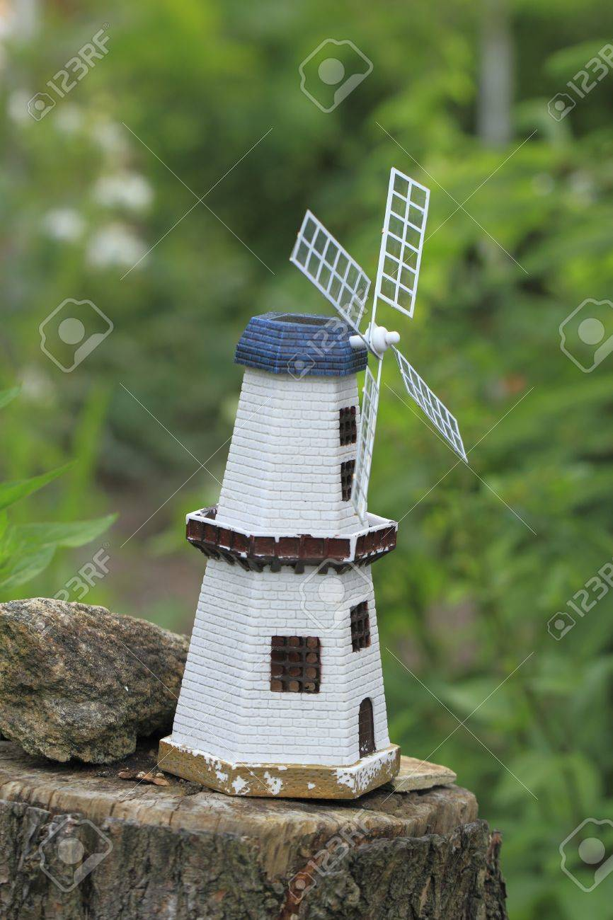 A Miniature Windmill As A Decoration In A Garden Stock Photo ...