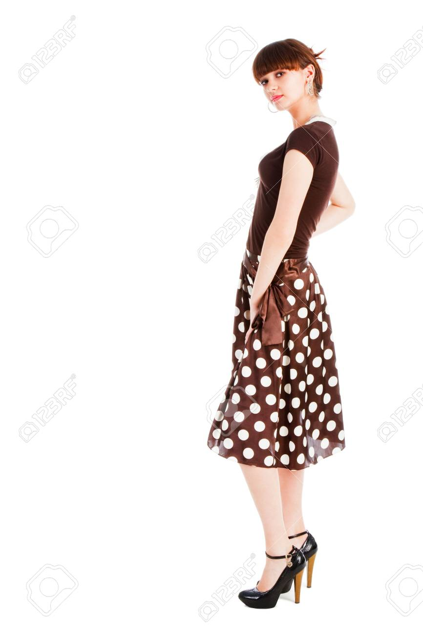 Picture of a young  sensuality  beautiful girl in blouse and spotted skirt. Isolate on white. Stock Photo - 6616716