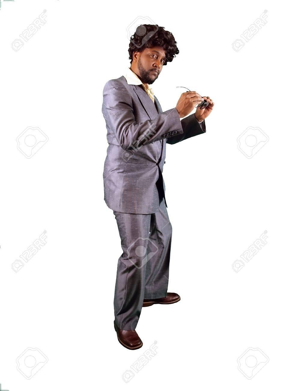 super popular ac1f8 d0e74 Un uomo vestito con un abito retrò anni '70 in stile pimp