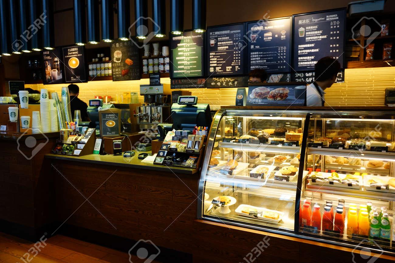 SHENZHEN, CHINA - OCTOBER 15, 2015: Starbucks Cafe Interior... Stock ...