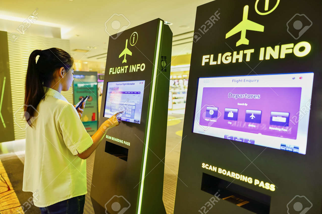 SINGAPORE - NOVEMBER 09, 2015: passenger in Changi Airport. Singapore Changi Airport, is the primary civilian airport for Singapore, and one of the largest transportation hubs in Southeast Asia - 55478921