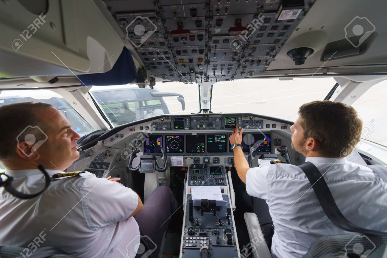 GENEVA - SEPTEMBER 11: Etihad Regional pilots in aircraft cockpit