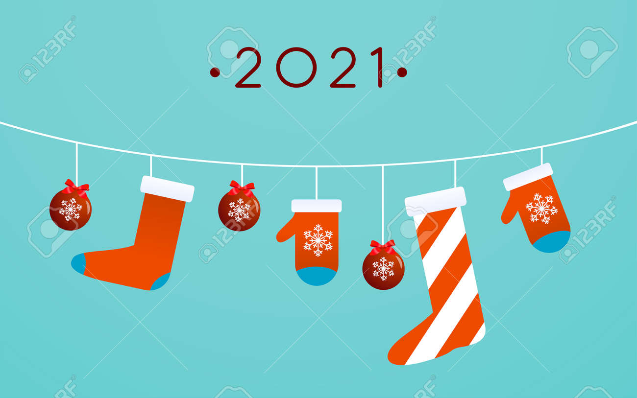 Christmas toys, stocking, and mittens are hanging on light blue background - 155329265