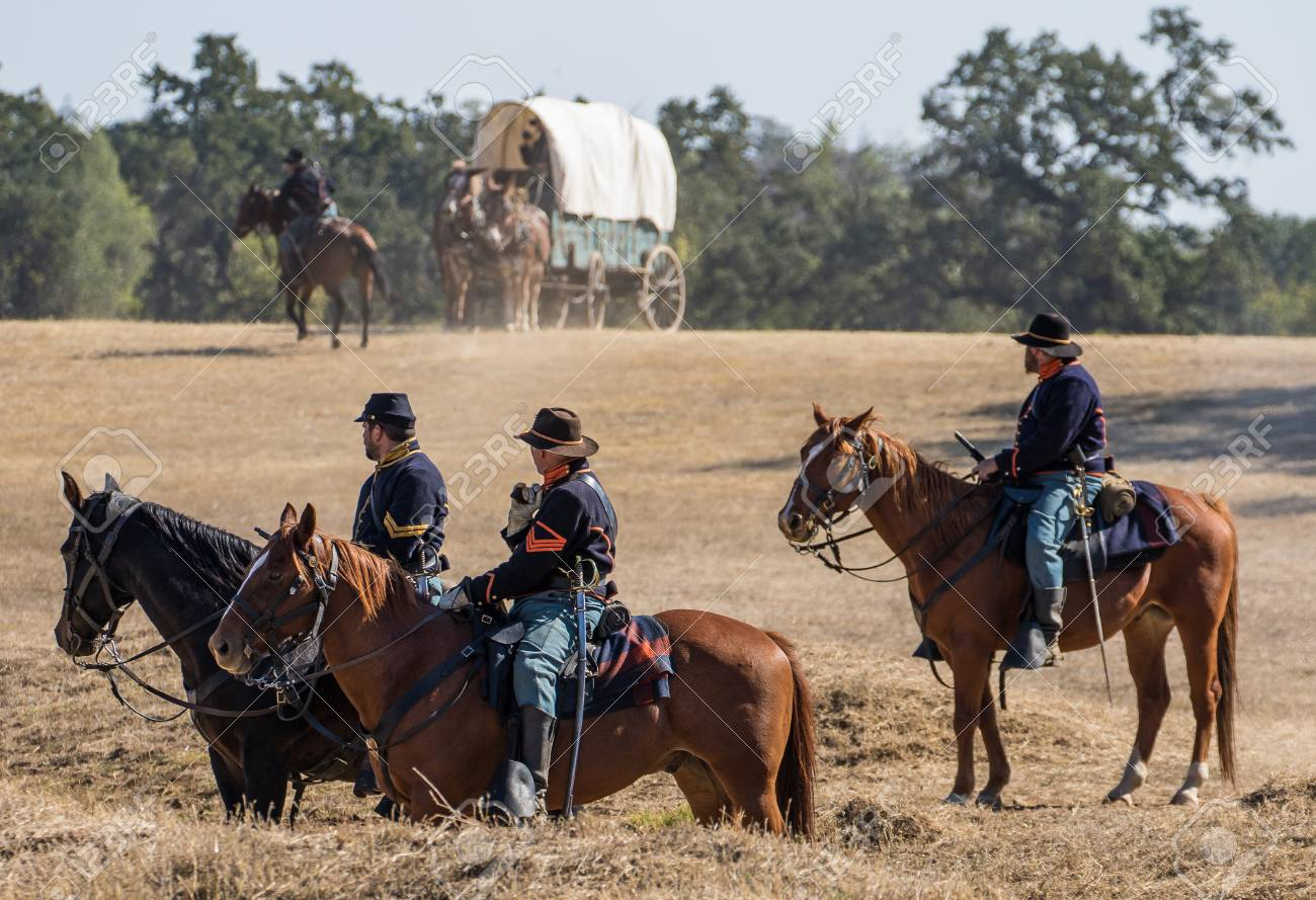 Cavalry scouts at war in a Civil War reenactment at Hawes Farm