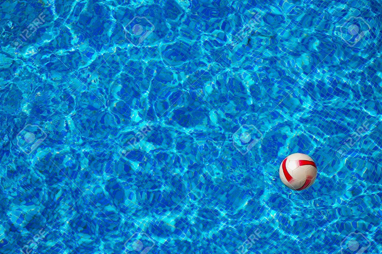 swimming pool beach ball background. Beach Ball Floating In The Blue Clear Water Of Swimming Pool With Mosaic  Bottom Stock Photo Beach Background