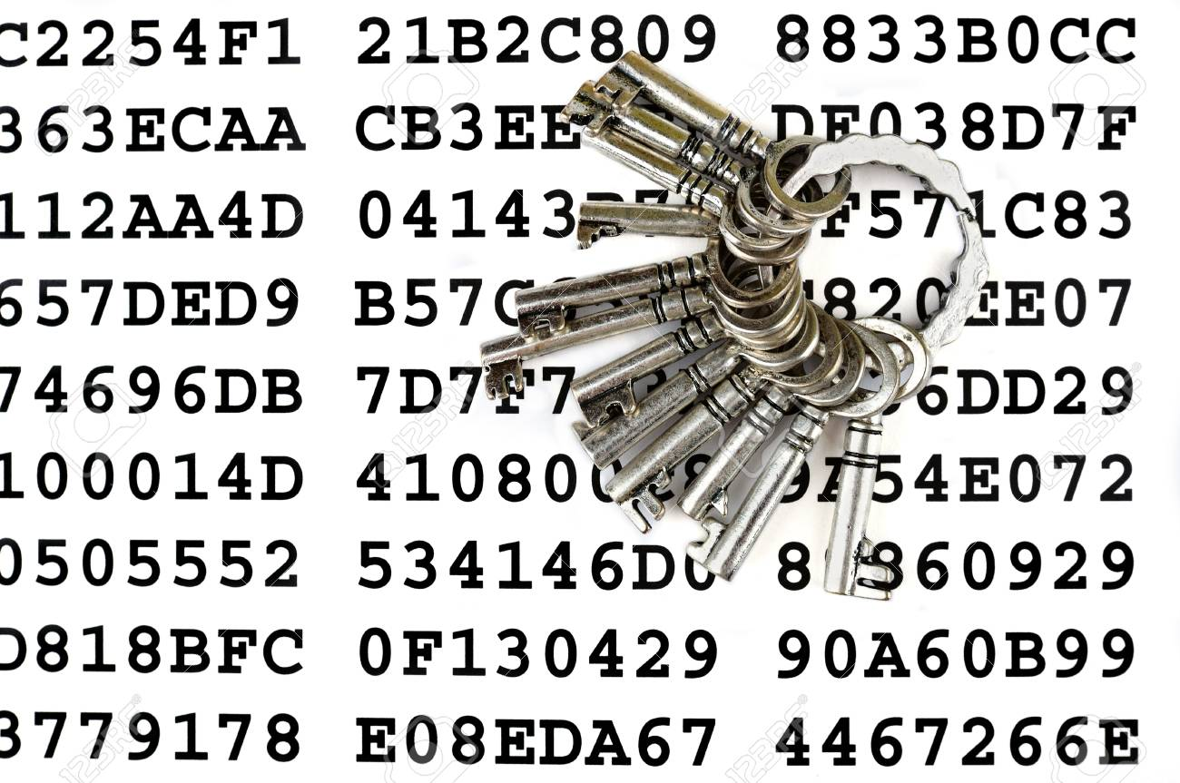 Bunch of silver keys on a sheet with encrypted data Stock Photo - 14437481