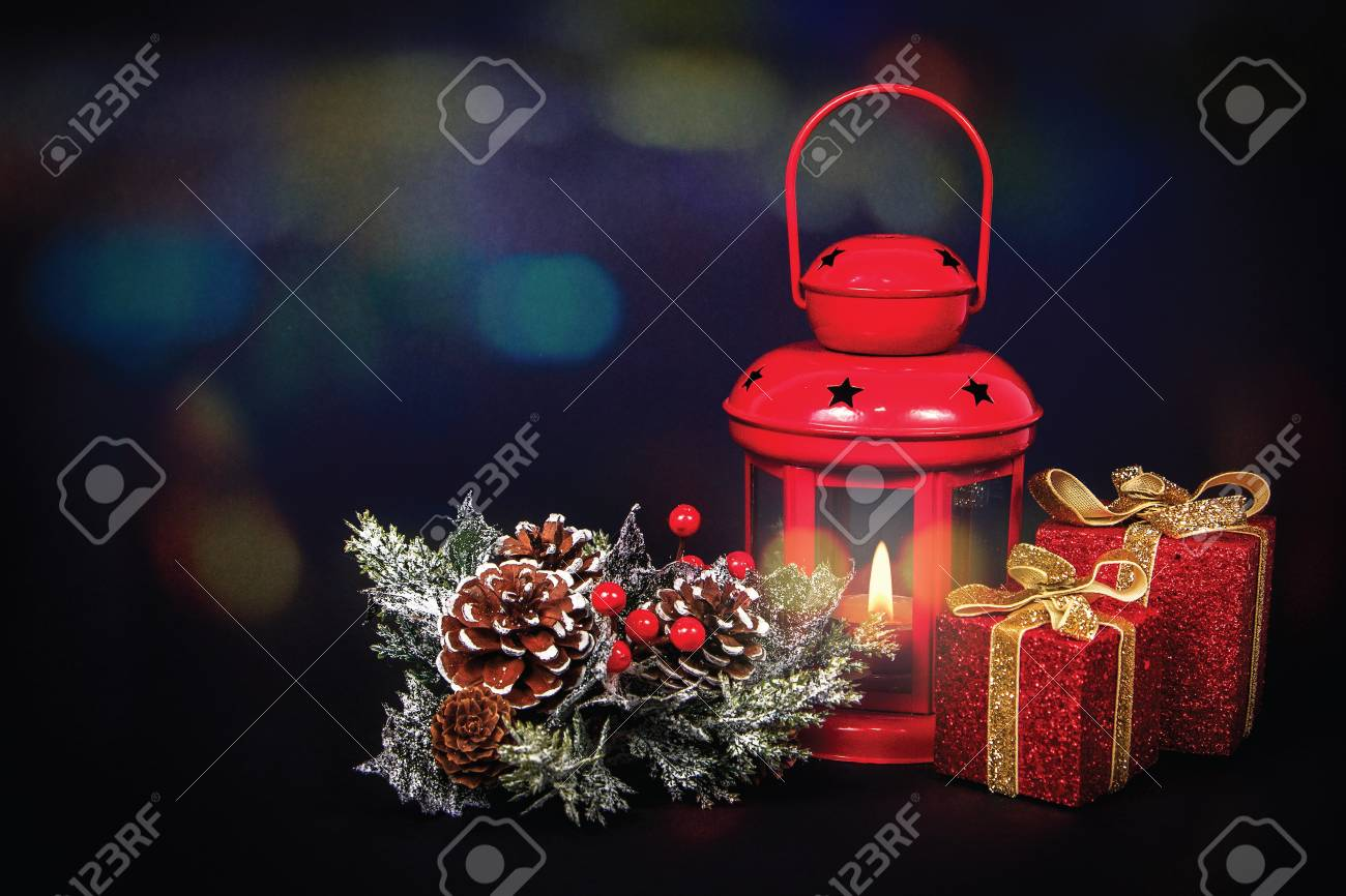 close up of a christmas decorations with colorful bokeh candle light shiny presents