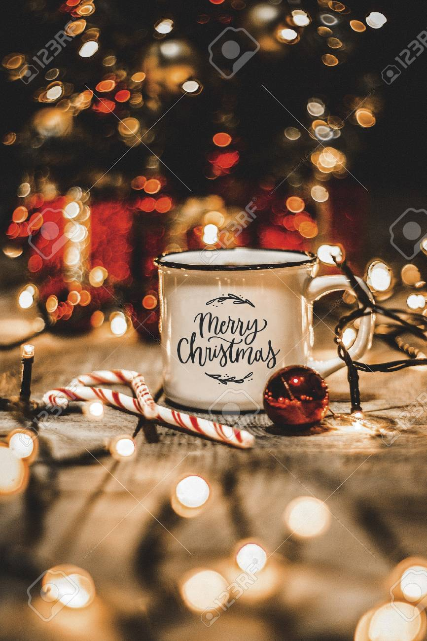 Christmas Lights White.Close Up Of A White Mug With Christmas Lights And Christmas Decorations